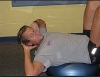 Coach Hacker Crunch Pose